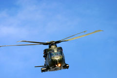 Army helicopter at RAF Fairford air tattoo show in flight. Helicopter raf army navy war flight rotor noise flight fly hover pilot Royalty Free Stock Photography