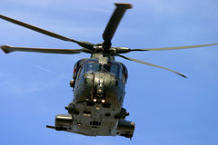 Army helicopter at RAF Fairford air tattoo show in flight. Helicopter raf army navy war flight rotor noise flight fly hover pilot Royalty Free Stock Images