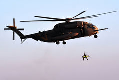Army Helicopter Rescue. An Israeli military helicopter CH-53 Sikorsky picks up a soldier after rescuing an injured soldier from the field Stock Image