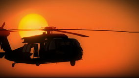 Army helicopter taking off at dawn or dusk