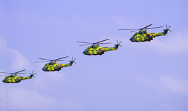 Army helicopters. In teamwork formation at airshow Stock Images