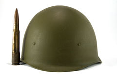 Army helmet and bullet Stock Photos