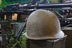 Army helmet and weapon Royalty Free Stock Photos