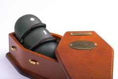 Army Helmets in Coffin Stock Photography