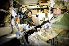 British Army training facilty on Salisbury Plain, England, UK. Army Infantryman inside an armoured personnel carrier royalty free stock image