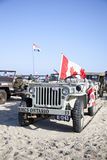 Army jeep of organization Kelly's Heroes riding on beach Royalty Free Stock Photography