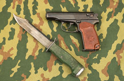Army knife and handgun. Russian army knife and handgun Royalty Free Stock Image