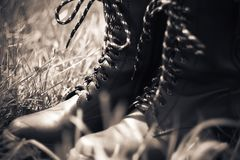 Army leather boots with a high top and striped laces stock photography