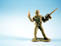 Army Man. Plastic army man on light blue field Royalty Free Stock Photo