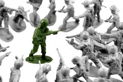 Army man surrounded by enemy soldiers Stock Photos