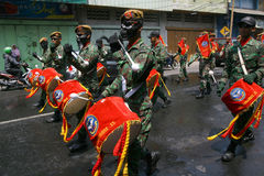 Army marching band. Performing in a parade in the city of Solo, Central Java, Indonesia Stock Photo