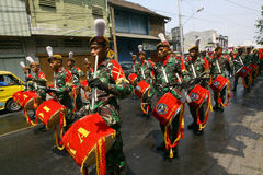Army marching band. Performing in a parade in the city of Solo, Central Java, Indonesia Royalty Free Stock Photo