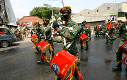 Army marching band. Performing in a parade in the city of Solo, Central Java, Indonesia Stock Photos