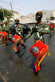 Army marching band. Performing in a parade in the city of Solo, Central Java, Indonesia Stock Images