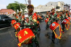 Army marching band. Performing in a parade in the city of Solo, Central Java, Indonesia Stock Photography