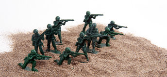 Army Men Toy Figurines Sand White royalty free stock photo