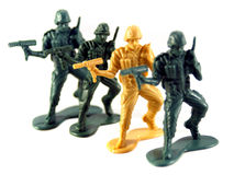 Army Men. A lineup of plastic soldiers becomes a metaphor for diversity, discrimination or differences Stock Photography