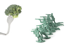 Army Men Attack Fork Stock Photo