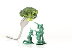 Army Men Attack Fork Stock Photography