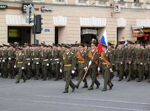 Army men carry the Russian flag Stock Photo
