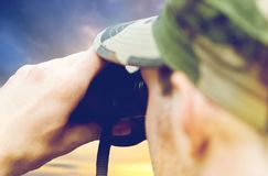 Close up of soldier looking to binocular Stock Images