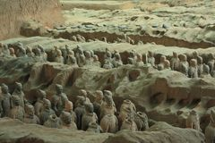 Army in the moats. China, Xi`an: Archaeological excavations of the clay army of the emperor Qin Shi Huang. The terracotta army is a figure of ancient Chinese stock photography