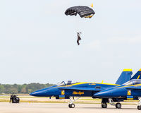 Army parachutist drops in at 2015 MCAS. Royalty Free Stock Photos