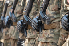 Army parade - armed soldiers in camouflage military uniform Royalty Free Stock Image