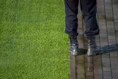 Security Guard standing next to chalk line on soccer field stock image