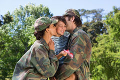 Army parents reunited with their son. On a sunny day Stock Photography