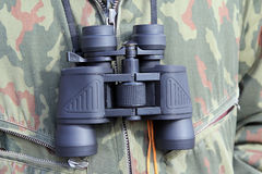 Army and people concept, black binocular hanging Royalty Free Stock Photography