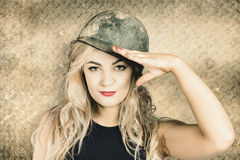 Army pin-up girl signing up for recruit enrolment Royalty Free Stock Images