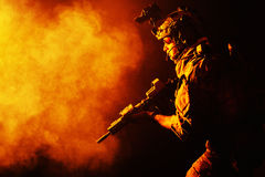 Army Ranger in field Uniforms. Security forces operator in Combat Uniforms with rifle, in the face of danger. Facing enemy, he is ready to fight. Studio contour Stock Photo
