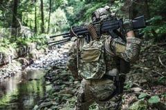 Army ranger machine gunner. United states army ranger machine gunner in the forest Stock Photo