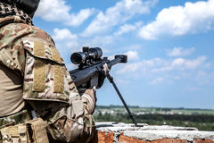Army ranger sniper. US Army ranger sniper with huge rifle Stock Image