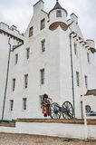 Perthshire,UK - 20 August 2016 : An army representative playing bagpipes at Blair Atholl castle. Royalty Free Stock Photo