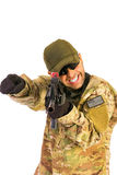 Army serviceman finger pointing identified threat isolated on wh royalty free stock photography