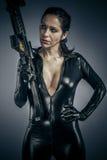 Army, Sexy girl military woman posing with guns. Stock Photos