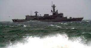 Army ship trough the rough sea stock photo