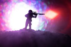 Army sniper with large-caliber sniper rifle seeking killing enemy. Silhouette on sky background. National security ensured, servic. Emen on guard. Battle scene Stock Photo