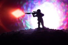 Army sniper with large-caliber sniper rifle seeking killing enemy. Silhouette on sky background. National security ensured, servic. Emen on guard. Battle scene Royalty Free Stock Images