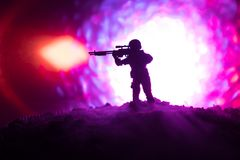 Army sniper with large-caliber sniper rifle seeking killing enemy. Silhouette on sky background. National security ensured, servic. Emen on guard. Battle scene Stock Photos