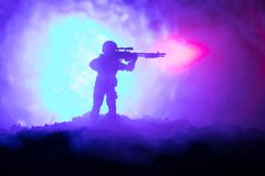 Army sniper with large-caliber sniper rifle seeking killing enemy. Silhouette on sky background. National security ensured, servic. Emen on guard. Battle scene Stock Photography