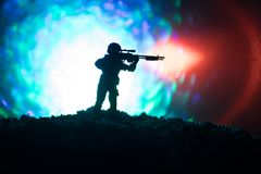Army sniper with large-caliber sniper rifle seeking killing enemy. Silhouette on sky background. National security ensured, servic. Emen on guard. Battle scene Stock Image