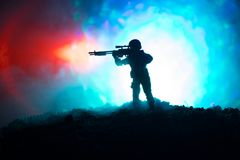 Army sniper with large-caliber sniper rifle seeking killing enemy. Silhouette on sky background. National security ensured, servic. Emen on guard. Battle scene Royalty Free Stock Image