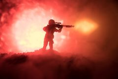 Army sniper with large-caliber sniper rifle seeking killing enemy. Silhouette on sky background. National security ensured, servic. Emen on guard. Battle scene Royalty Free Stock Photography