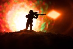 Army sniper with large-caliber sniper rifle seeking killing enemy. Silhouette on sky background. National security ensured, servic. Emen on guard. Battle scene Stock Images