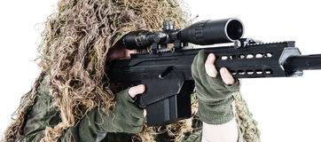 Army sniper wearing a ghillie suit Stock Images