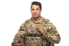 Army soldier against white background. Portrait of army soldier standing against white background stock photo