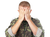 Army soldier closing eyes with hands Royalty Free Stock Photos